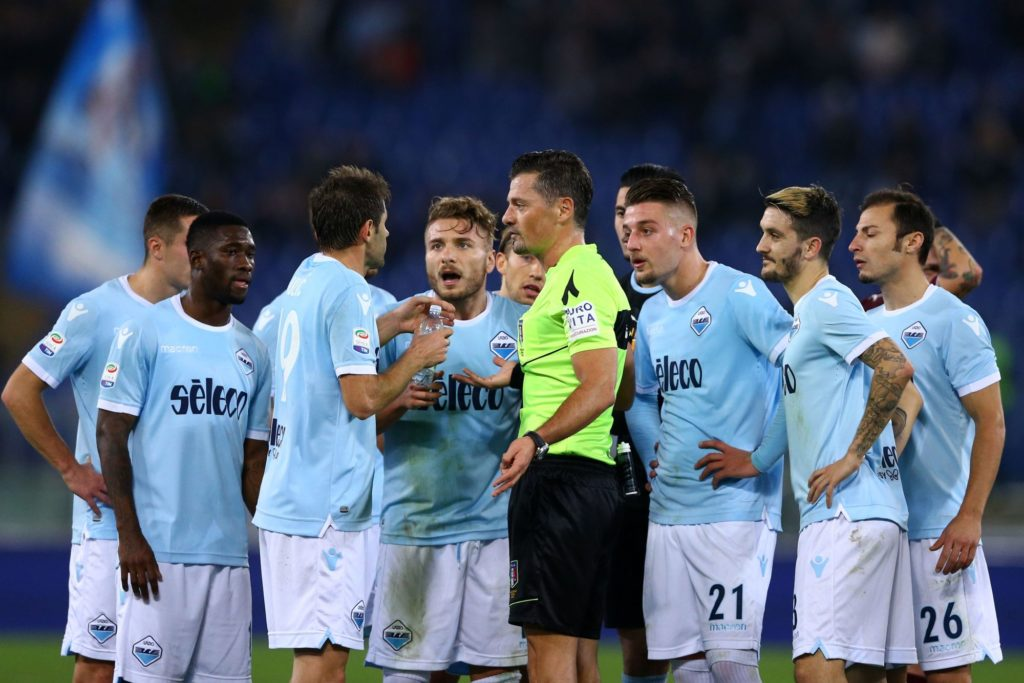 Lazio payers reclaiming with the referee Giacomelli after the red card to Ciro Immobile during the Italian Serie A football match Lazio versus Torino on December 11, 2017 at the Olympic Stadium in Rome.  (Photo by Matteo Ciambelli/NurPhoto)