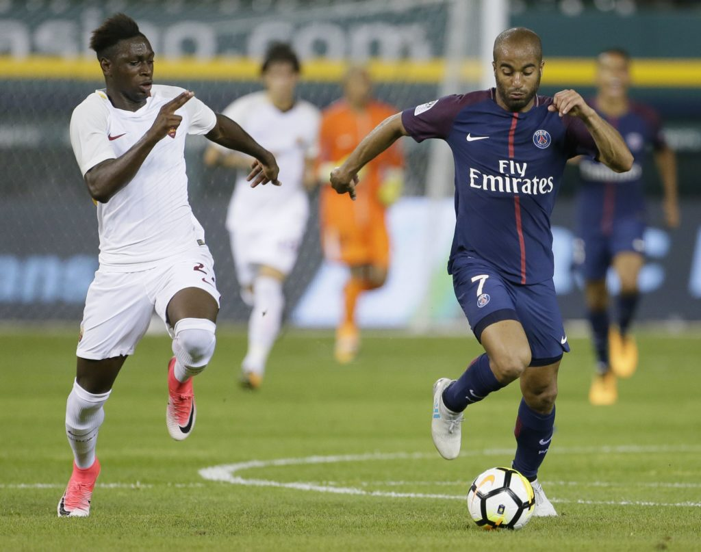 DETROIT, MI - JULY 19: Moustapha Seck #27 of AS Romaduring pursues Lucas Moura #7 of Paris Saint-Germain down the pitch during the second half at Comerica Park on July 19, 2017 in Detroit, Michigan. After playing to a 1-1 tie, Paris Saint-Germain won the penalty kicks 5-3 for the victory.   Duane Burleson/Getty Images/AFP