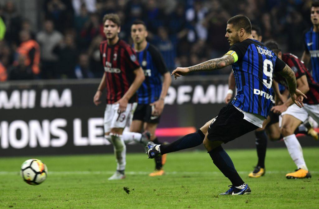 Inter Milan's Captain Argentinian forward Mauro Icardi kicks and score a penalty during the Italian Serie A football match Inter Milan Vs AC Milan on October 15, 2017 at the 'San Siro Stadium' in Milan.  / AFP PHOTO / MIGUEL MEDINA