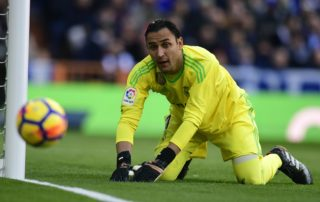 """Real Madrid's Costa Rican goalkeeper Keylor Navas eyes the ball during the Spanish League """"Clasico"""" football match Real Madrid CF vs FC Barcelona at the Santiago Bernabeu stadium in Madrid on December 23, 2017.  / AFP PHOTO / JAVIER SORIANO"""