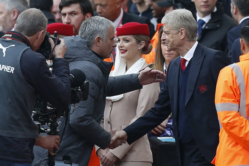Arsenal's French manager Arsene Wenger (R) shakes hands with Manchester United's Portuguese manager Jose Mourinho ahead of the English Premier League football match between Arsenal and Manchester United at the Emirates Stadium in London on May 7, 2017.  / AFP PHOTO / IKIMAGES / Ian KINGTON / RESTRICTED TO EDITORIAL USE. No use with unauthorized audio, video, data, fixture lists, club/league logos or 'live' services. Online in-match use limited to 45 images, no video emulation. No use in betting, games or single club/league/player publications.  /