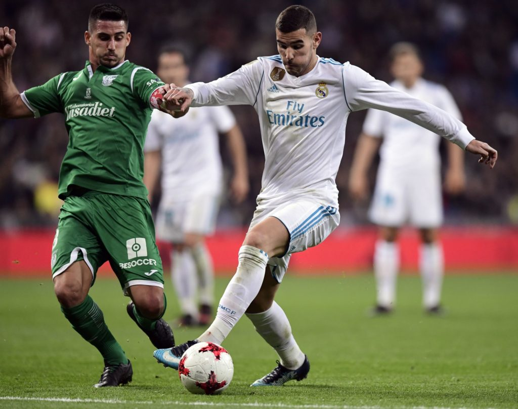 Leganes' Brazilian midfielder Gabriel Appelt (L) vies with Real Madrid's French defender Theo Hernandez during the Spanish 'Copa del Rey' (King's cup) quarter-final second leg football match between Real Madrid CF and CD Leganes at the Santiago Bernabeu stadium in Madrid on January 24, 2018.  / AFP PHOTO / JAVIER SORIANO
