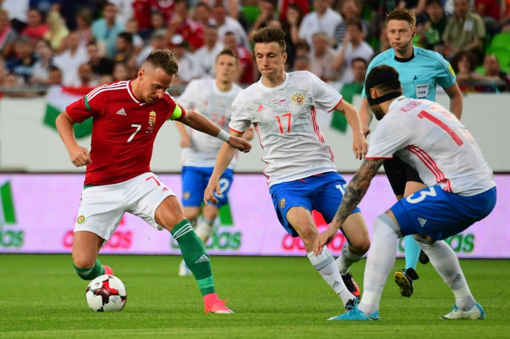 Russia's Aleksandr Golovin (C) vies with his teammate Fedor Kudryashov (R) and Hungary's captain Balazs Dzsudzsak (L) during a friendly football match between their teams on June 5, 2017 in Groupama Arena of Budapest.  / AFP PHOTO / ATTILA KISBENEDEK