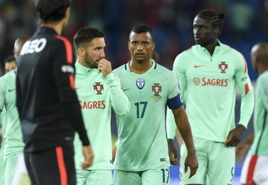 Portugal's midfielder Joao Moutinho, teammates forward Nani and Eder leaves the field at the end of the FIFA World Cup WC 2018 football qualifier between Switzerland and Portugal at the St. Jakob-Park stadium in Basel on September 6, 2016. / AFP PHOTO / FABRICE COFFRINI
