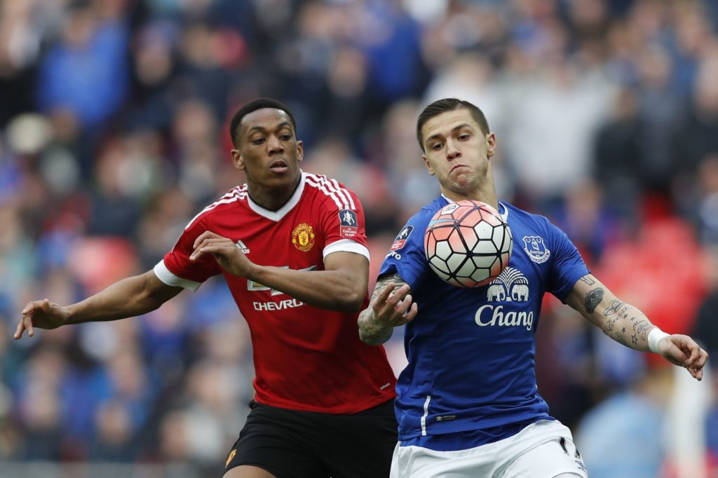 Manchester United's French striker Anthony Martial (L) challenges Everton's Bosnian midfielder Muhamed Besic (R) during the English FA Cup semi-final football match between Everton and Manchester United at Wembley Stadium in London on April 23, 2016. / AFP PHOTO / ADRIAN DENNIS / NOT FOR MARKETING OR ADVERTISING USE / RESTRICTED TO EDITORIAL USE