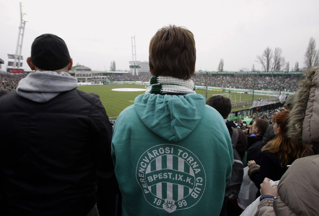 TO GO WITH AFP STORY BY PETER MURPHY  This picture taken on March 10, 2013 shows a fan wearing a sweater with the logo of Ferencvarosi Torna Club ahead of the soccer match of Hungarian football clubs Ferencvaros vs Ujpest at the Florian Albert Stadium in Budapest, Hungary, prior to its demolition. A new arena will be build to host 22,500 fans as of 2014. AFP PHOTO / PETER KOHALMI / AFP PHOTO / PETER KOHALMI