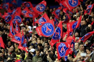 Supporters of Paris Saint-Germain cheer their team during the UEFA Champions League quarter finals first leg football match between Paris Saint Germain (PSG) and Manchester City on April 6, 2016 at the Parc des Princes stadium in Paris.