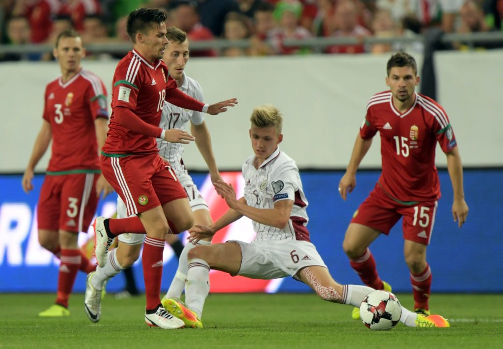 Latvia's Davis Indrans (C) and Edgars Vardanjans (3rd L) vie with Hungary's Mihaly Korhut (L), Zoltan Stieber (2nd L) and Mate Patkai (R) during the FIFA World Cup 2018 qualification football match between Hungary and Latvia in Budapest on August 31, 2017.  / AFP PHOTO / ATTILA KISBENEDEK