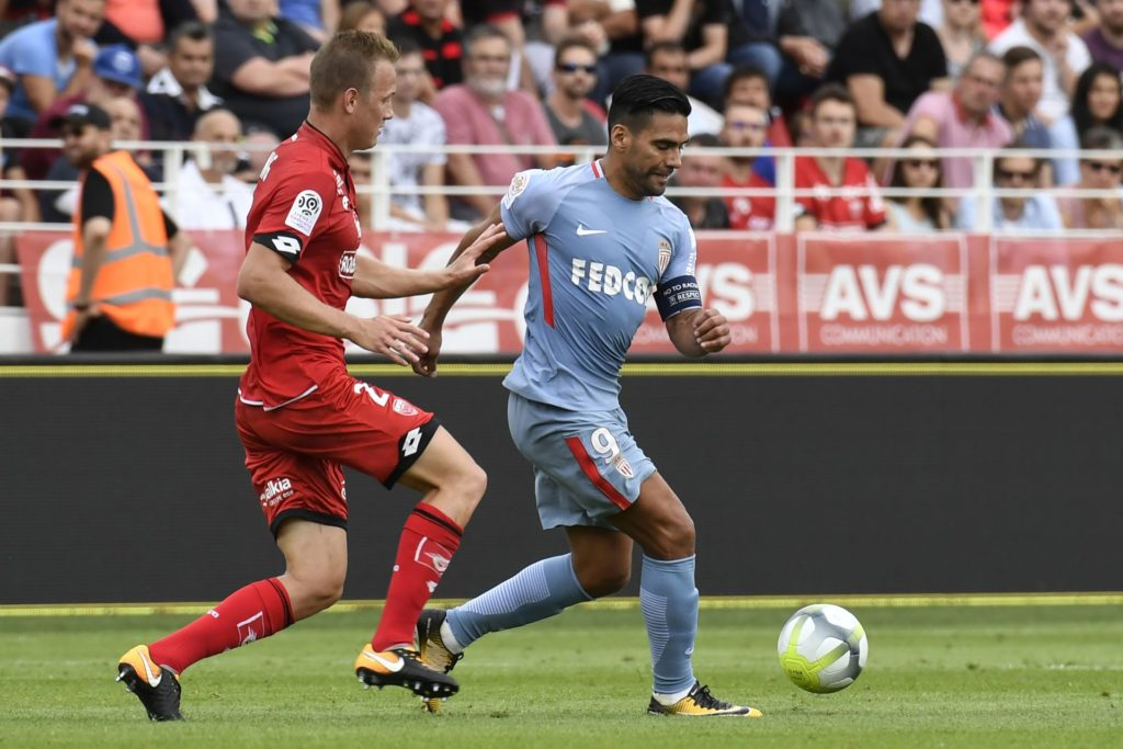 Monaco's Colombian forward Radamel Falcao (R) vies with Dijon's Hungarian defender Adam Lang (L) during the French L1 football match between Dijon FCO and AS Monaco, on August 13, 2017 at Gaston Gerard stadium in Dijon, northern France. / AFP PHOTO / PHILIPPE DESMAZES