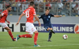 England' Harry Kane (R) scores a goal for England during the FIFA 2018 World Cup Qualifying Group F Match Malta vs England at the National Stadium in Ta'Qali on September 1, 2017. / AFP PHOTO / Matthew Mirabelli / Malta OUT