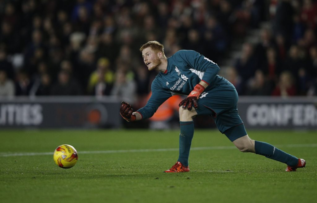 Liverpool's Hungarian goalkeeper Adam Bogdan rolls the ball to a teammate during the English League Cup quarter-final football match between Southampton and Liverpool at St Mary's Stadium in Southampton, southern England on December 2, 2015.   AFP PHOTO / ADRIAN DENNIS  RESTRICTED TO EDITORIAL USE. No use with unauthorized audio, video, data, fixture lists, club/league logos or 'live' services. Online in-match use limited to 75 images, no video emulation. No use in betting, games or single club/league/player publications. / AFP PHOTO / ADRIAN DENNIS