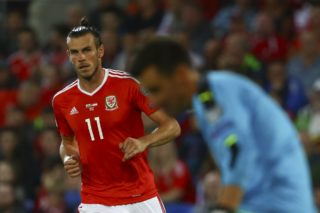 Wales' striker Gareth Bale looks on during the FIFA World Cup 2018 qualification international football match between Wales and Austria in Cardiff, south Wales, on September 2, 2017. / AFP PHOTO / GEOFF CADDICK