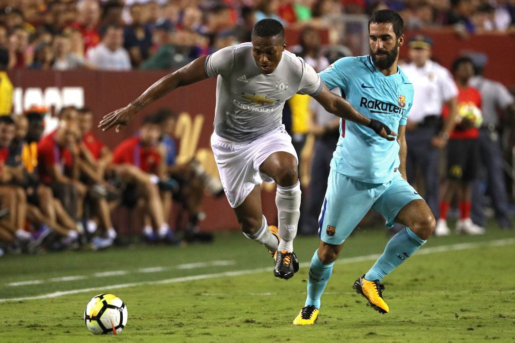 LANDOVER, MD - JULY 26: Luis Antonio Valencia #25 of Manchester United and Arda Turan #7 of Barcelona battle for the ball in the second half during the International Champions Cup match at FedExField on July 26, 2017 in Landover, Maryland. (Photo by Patrick Smith/Getty Images)