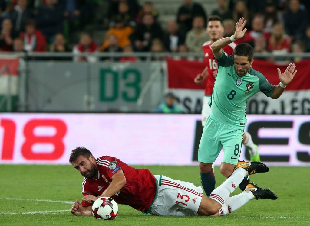 Portugal's Joao Moutinho (R) fights for the ball with Hungary's Daniel Böde during the FIFA World Cup 2018 qualification football match between Hungary and Portugal at The Grupama Arena in Budapest on September 3, 2017.   / AFP PHOTO / Peter Kohalmi