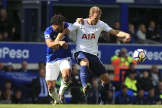 Tottenham Hotspur's English striker Harry Kane (R) holds off Everton's English-born Welsh defender Ashley Williams (L) during the English Premier League football match between Everton and Tottenham Hotspur at Goodison Park in Liverpool, north west England on September 9, 2017. / AFP PHOTO / Lindsey PARNABY / RESTRICTED TO EDITORIAL USE. No use with unauthorized audio, video, data, fixture lists, club/league logos or 'live' services. Online in-match use limited to 75 images, no video emulation. No use in betting, games or single club/league/player publications.  /