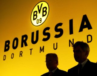 (dpa files) - Club President Gerd Niebaum (L) and General Manager Michael Meier of German Bundesliga side Borussia Dortmund sit on the stage during the club's general meeting in Dortmund, Germany, 23 November 2003. Dortmund, the Bundeliga's only stock exchange listed club, presented a record loss of 67.7 million euros for the 2003/2004 season during a press conference on 8 October 2004. Niebaum and Meier have been attacked in recent months by analysts, shareolders and new majority shareholder Florian Homm. The turbulent days following the press conference were marked by further attacks, newspaper reports calling for resignations and a general worsening of the crisis.