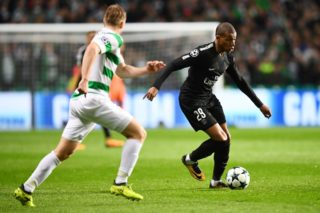 Paris Saint-Germain's French striker Kylian Mbappe runs with the ball during the UEFA Champions League Group B football match between Celtic and Paris Saint-Germain (PSG) at Celtic Park in Glasgow, on September 12, 2017. / AFP PHOTO / FRANCK FIFE