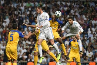 Real Madrid's forward from Wales Gareth Bale (2ndL) heads the ball with APOEL's defender from Brazil Carlao (2ndR) and Real Madrid's forward from Portugal Cristiano Ronaldo during the UEFA Champions League football match Real Madrid CF vs APOEL FC at the Santiago Bernabeu stadium in Madrid on September 13, 2017. / AFP PHOTO / PIERRE-PHILIPPE MARCOU