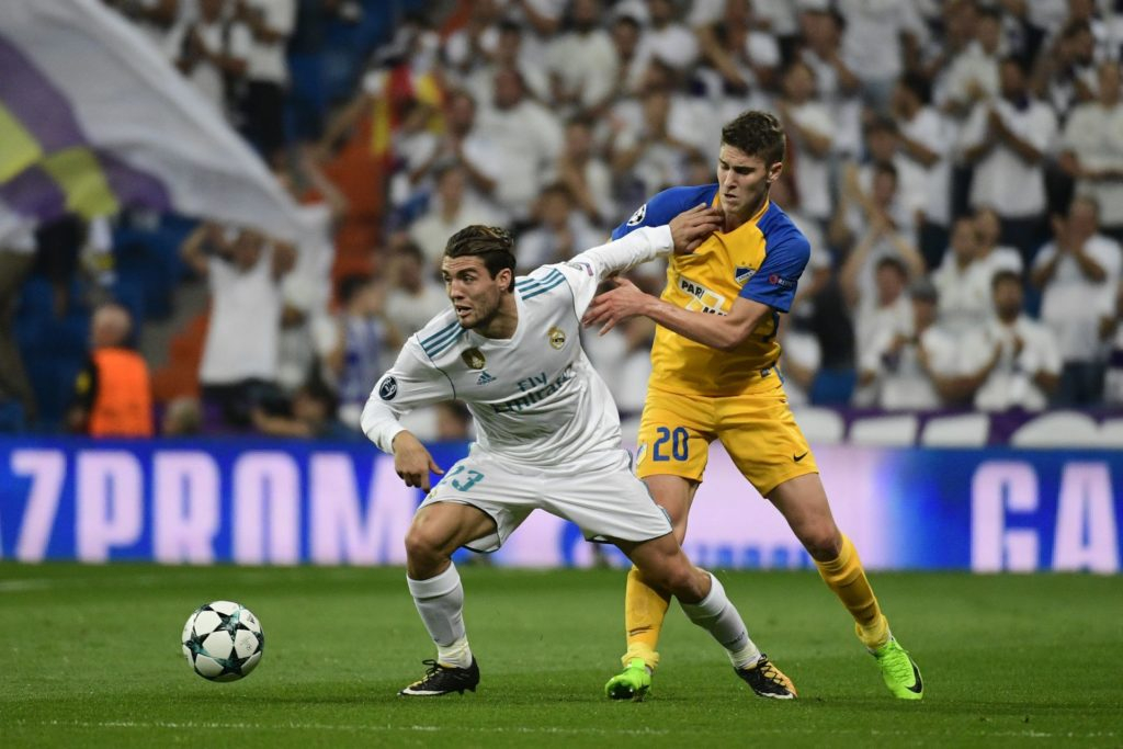 Real Madrid's midfielder from Croatia Mateo Kovacic (L) vies with APOEL Nicosia's midfielder from Hungary Roland Sallai during the UEFA Champions League football match Real Madrid CF vs APOEL FC at the Santiago Bernabeu stadium in Madrid on September 13, 2017. / AFP PHOTO / PIERRE-PHILIPPE MARCOU
