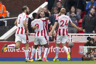 Stoke City's Spanish striker Jese (C) celebrates with teammates after scoring the opening goal of the English Premier League football match between Stoke City and Arsenal at the Bet365 Stadium in Stoke-on-Trent, central England on August 19, 2017. / AFP PHOTO / Roland Harrison / RESTRICTED TO EDITORIAL USE. No use with unauthorized audio, video, data, fixture lists, club/league logos or 'live' services. Online in-match use limited to 75 images, no video emulation. No use in betting, games or single club/league/player publications.  /