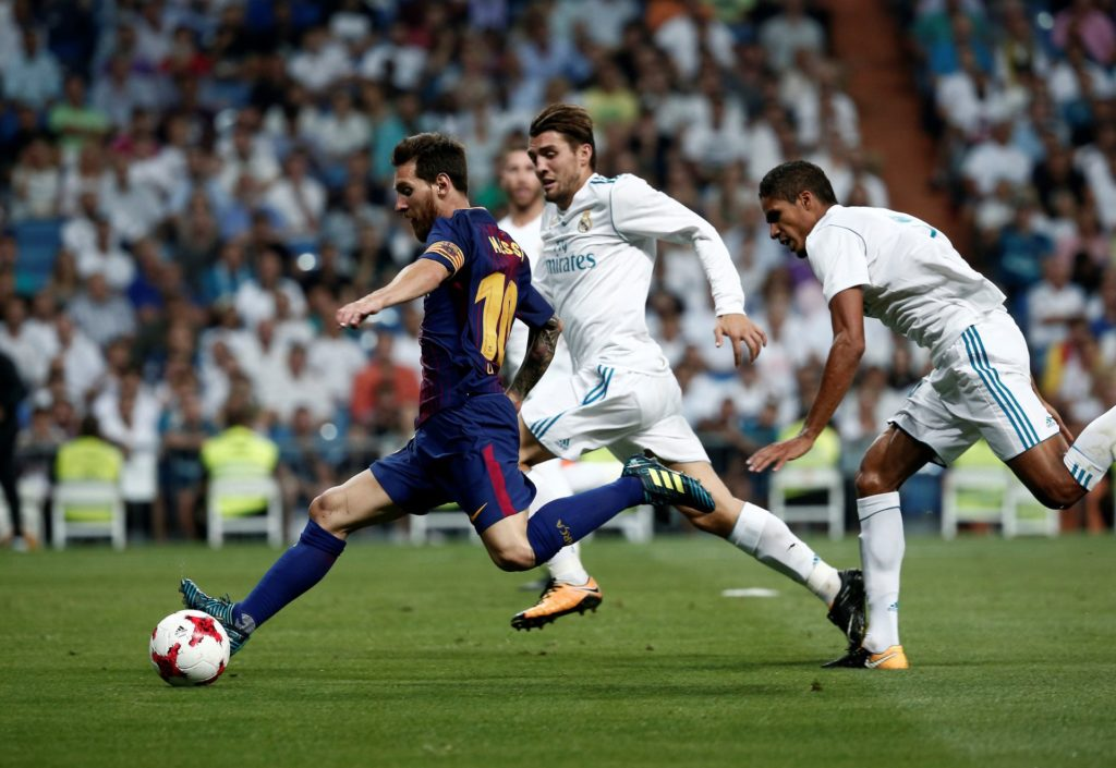 MADRID, SPAIN - AUGUST 17: Lionel Messi (L) of Barcelona in action against the Mateo Kovacic (2nd L) of Real Madrid during the Spanish Super Cup return match between Real Madrid and Barcelona at Santiago Bernabeu Stadium in Madrid, Spain on August 17, 2017.  Burak Akbulut / Anadolu Agency