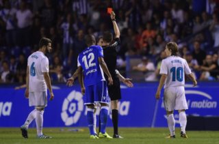 Real Madrid's defender Sergio Ramos is shown a red card by the referee during the Spanish league footbal match RC Deportivo de la Coruna vs Real Madrid CF at the Municipal de Riazor stadium in La Coruna on August 20, 2017. Real Madrid won 3-0. / AFP PHOTO / MIGUEL RIOPA