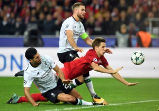 """Liverpool's midfielder from Germany Emre Can, Spartak Moscow's midfielder from Croatia Mario Pasalic and Liverpool's midfielder from England Jordan Henderson vie for the ball during the UEFA Champions League Group E football match between FC Spartak Moscow and Liverpool FC at the Otkrytie Arena stadium in Moscow on September 26, 2017. / AFP PHOTO / Kirill KUDRYAVTSEV / """"The erroneous mention[s] appearing in the metadata of this photo by Kirill KUDRYAVTSEV has been modified in AFP systems in the following manner: [Liverpool's midfielder from England Jordan Henderson] instead of [Liverpool's defender from Spain Alberto Moreno]. Please immediately remove the erroneous mention[s] from all your online services and delete it (them) from your servers. If you have been authorized by AFP to distribute it (them) to third parties, please ensure that the same actions are carried out by them. Failure to promptly comply with these instructions will entail liability on your part for any continued or post notification usage. Therefore we thank you very much for all your attention and prompt action. We are sorry for the inconvenience this notification may cause and remain at your disposal for any further information you may require."""""""