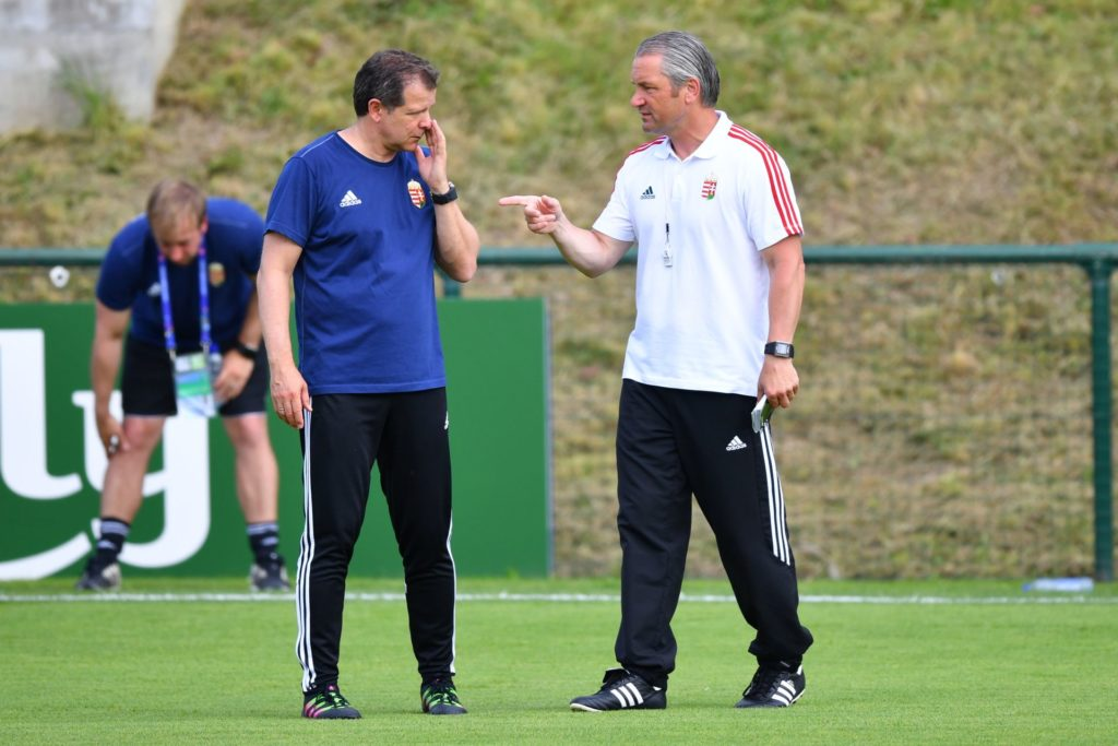Bernd Storck (R), the head coach of Hungary, and assistant coach Andreas Moeller talk during a training session at Stade des Gerland venue in Lyon, France, 21 June 2016. Hungary will face Portugal in the UEFA EURO 2016 Group F soccer match on 22 June 2016. Photo: Uwe Anspach/dpa (RESTRICTIONS APPLY: For editorial news reporting purposes only. Not used for commercial or marketing purposes without prior written approval of UEFA. Images must appear as still images and must not emulate match action video footage. Photographs published in online publications (whether via the Internet or otherwise) shall have an interval of at least 20 seconds between the posting.)
