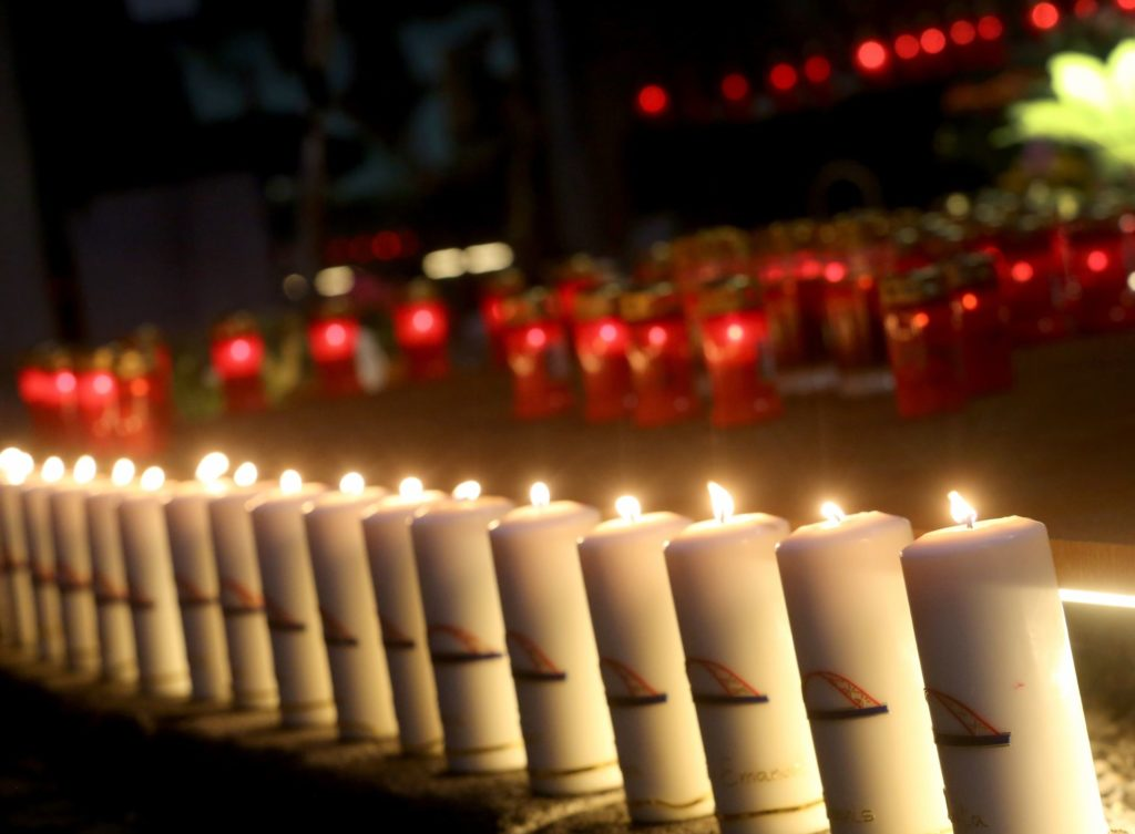 """Candles are set up in mourning during the """"Night of a Thousand Lights"""" at the place of the tragedy in Duisburg, Germany, 23 July 2017. Seven years ago, in the year 2010, 21 people lost their lives during the Loveparade. Photo: Roland Weihrauch/dpa"""