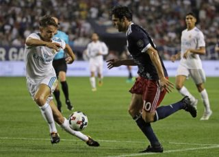 CHICAGO, IL - AUGUST 02: Kaka #10 of the MLS All-Stars challenges Marcos Liorente #18 of Real Madrid during the 2017 MLS All- Star Game at Soldier Field on August 2, 2017 in Chicago, Illinois.   Jonathan Daniel/Getty Images/AFP