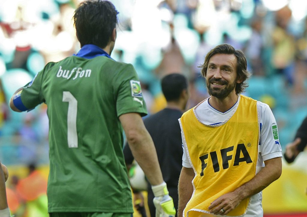 Italy's midfielder Andrea Pirlo (R) walks towards goalkeeper Gianluigi Buffon after he stopped the penalty taken by Uruguay's midfielder Walter Gargano (out of frame) in the penalty shoot-out and won the FIFA Confederations Cup Brazil 2013 third-place football match, at the Fonte Nova Arena in Salvador, on June 30, 2013. AFP PHOTO / DANIEL GARCIA / AFP PHOTO / DANIEL GARCIA