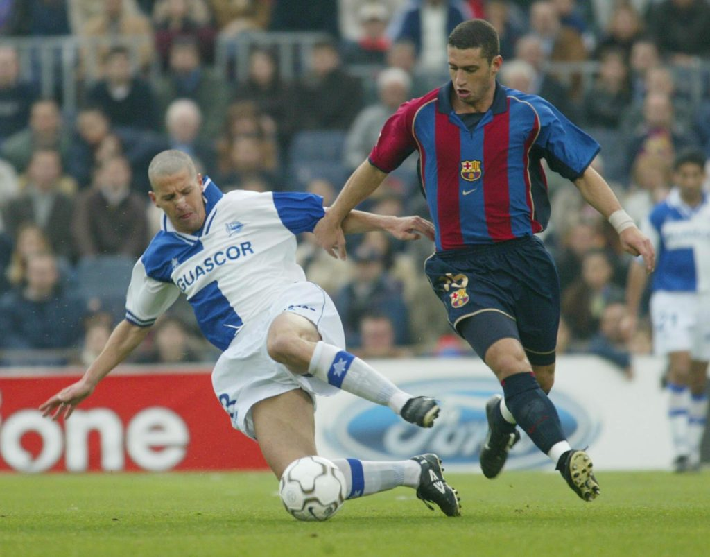 14 Apr 2002:  Ibon Begona of Alaves and Fabio Rochemback of Barcelona in action during the Primera Liga match between Barcelona and Alaves, played at the Camp Nou Stadium, Barcelona.  DIGITAL IMAGE. Mandatory Credit: Firo Foto/Getty Images