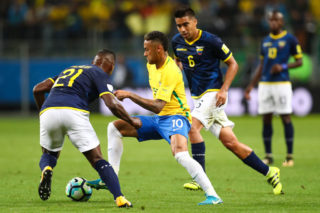PORTO ALEGRE, BRAZIL - AUGUST 31: Neymar (C) of Brazil struggles for the ball with Gabriel Achilier of Ecuador during a match between Brazil and Ecuador as part of 2018 FIFA World Cup Russia Qualifier at Arena do Gremio on August 31, 2017 in Porto Alegre, Brazil. (Photo by Buda Mendes/Getty Images)