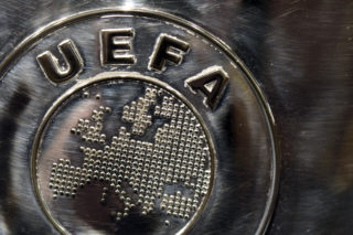 NYON, SWITZERLAND - JULY 18:  The UEFA logo is seen on the UEFA Champions League trophy as it is prepared for the UEFA 2014/15 Champions League third qualifying rounds draw at the UEFA headquarters, The House of European Football, on July 18, 2014 in Nyon, Switzerland.  (Photo by Harold Cunningham/Getty Images for UEFA)
