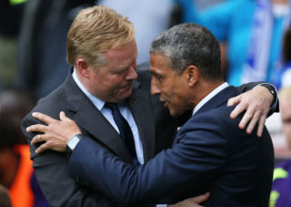 BRIGHTON, ENGLAND - OCTOBER 15:  Ronald Koeman, Manager of Everton embraces Chris Hughton, Manager of Brighton and Hove Albion ahead of the Premier League match between Brighton and Hove Albion and Everton at Amex Stadium on October 15, 2017 in Brighton, England.  (Photo by Steve Bardens/Getty Images)