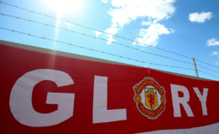 STOCKHOLM, SWEDEN - MAY 24:  A Manchester United flag with the word glory during the UEFA Europa League Final match between Ajax and Manchester United at Friends Arena on May 24, 2017 in Stockholm, Sweden. (Photo by Catherine Ivill - AMA/Getty Images)