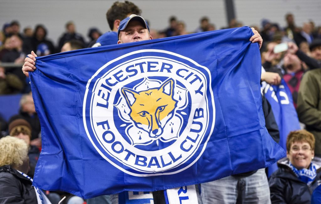 Leicester City's supporter holds his team's flag prior to the UEFA Champions League group G football match between FC Copenhagen and Leicester City FC at the Telia Parken stadium in Copenhagen on November 2, 2016.  / AFP PHOTO / JONATHAN NACKSTRAND