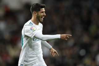 Real Madrid's Spanish midfielder Marco Asensio celebrates after scoring a goal during the Spanish league football match Real Madrid CF vs UD Las Palmas at the Santiago Bernabeu stadium in Madrid on November 5, 2017. / AFP PHOTO / GABRIEL BOUYS