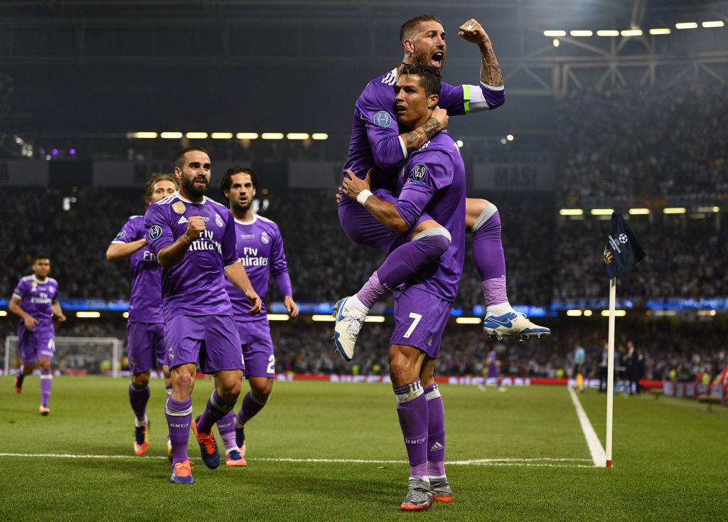 CARDIFF, WALES - JUNE 03:  Cristiano Ronaldo of Real Madrid celebrates scoring his sides first goal with Sergio Ramos of Real Madrid during the UEFA Champions League Final between Juventus and Real Madrid at National Stadium of Wales on June 3, 2017 in Cardiff, Wales.  (Photo by David Ramos/Getty Images)