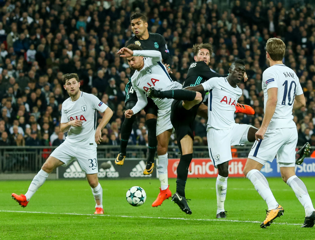 LONDON, ENGLAND - NOVEMBER 01: Dele Alli of Tottenham Hotspur, Davinson Sanchez of Tottenham Hotspur, Casemiro of Real Madrid and Sergio Ramos of Real Madrid battle for the ball during the UEFA Champions League group H match between Tottenham Hotspur and Real Madrid at Wembley Stadium on November 1, 2017 in London, United Kingdom. (Photo by TF-Images/TF-Images via Getty Images)