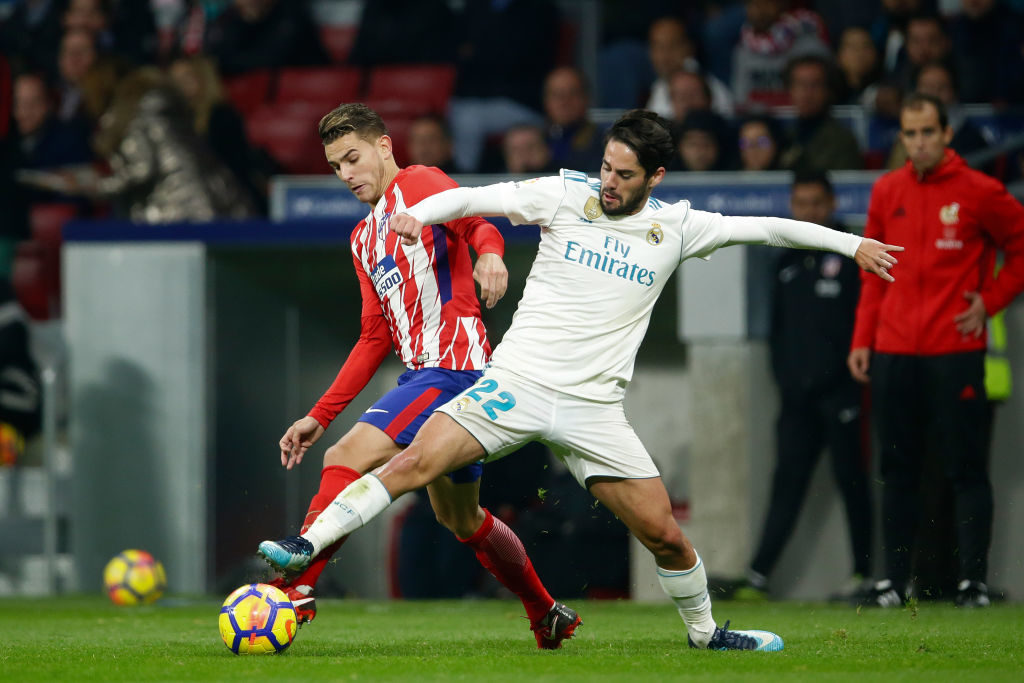 MADRID, SPAIN - NOVEMBER 18: Lucas Hernandez of Atletico Madrid, Isco of Real Madrid  during the Spanish Primera Division   match between Atletico Madrid v Real Madrid at the Estadio Wanda Metropolitano on November 18, 2017 in Madrid Spain (Photo by Eric Verhoeven/Soccrates/Getty Images)