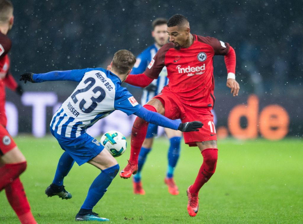 Berlin's Mitchell Weiser (C) and Eintracht's Kevin-Prince Boateng (R) vying for the ball during the German Bundesliga soccer match between Hertha BSC and Eintracht Frankfurt in the Olympic Stadium in Berlin, Germany, 03 December 2017.   EMBARGO CONDITIONS - ATTENTION: The DFB prohibits the utilisation and publication of sequential pictures on the internet and other online media during the match (including half-time). ATTENTION: BLOCKING PERIOD! The DFB permits the further utilisation and publication of the pictures for mobile services (especially MMS) and for DVB-H and DMB only after the end of the match. Photo: Annegret Hilse/dpa