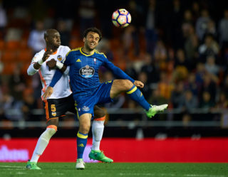 VALENCIA, SPAIN - APRIL 06:  Eliaquim Mangala (L) of Valencia competes for the ball with Giuseppe Rossi of Celta de Vigo during the La Liga match between Valencia CF and RC Celta de Vigo at Mestalla Stadium on April 6, 2017 in Valencia, Spain.  (Photo by fotopress/Getty Images)