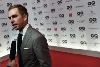 """Former football player Philipp Lahm speaks to reporters on the red carpet as he arrives for the GQ """"Men Of The Year"""" awards ceremony in Berlin on November 9, 2017. / AFP PHOTO / John MACDOUGALL"""