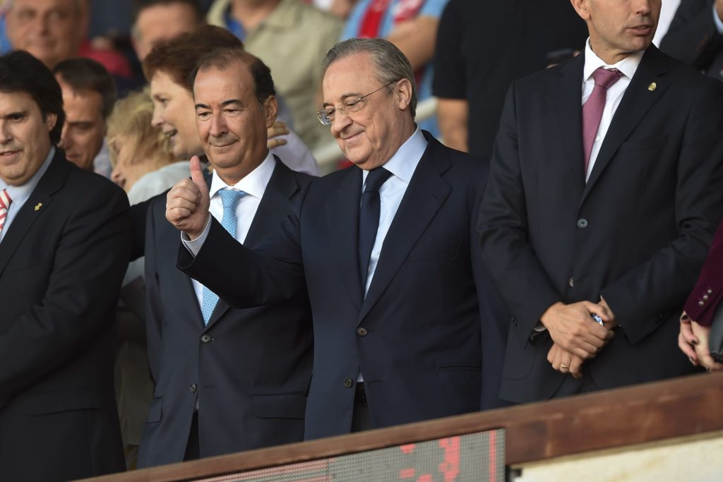 President of Real Madrid Florentino Perez (C) thumbs up from the stands during the Spanish league football match Girona FC vs Real Madrid CF at the Montilivi stadium in Girona on October 29, 2017. / AFP PHOTO / Josep LAGO