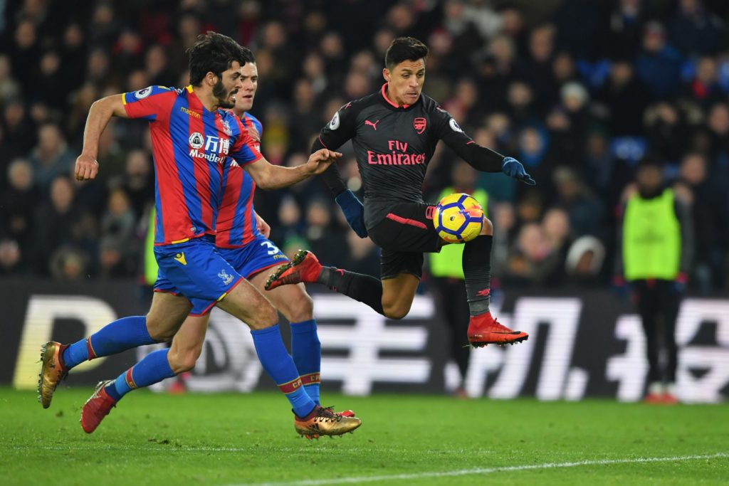 Arsenal's Chilean striker Alexis Sanchez (R) controls the ball on his way to score the their third goal during the English Premier League football match between Crystal Palace and Arsenal at Selhurst Park in south London on December 28, 2017. / AFP PHOTO / Ben STANSALL / RESTRICTED TO EDITORIAL USE. No use with unauthorized audio, video, data, fixture lists, club/league logos or 'live' services. Online in-match use limited to 75 images, no video emulation. No use in betting, games or single club/league/player publications.  /