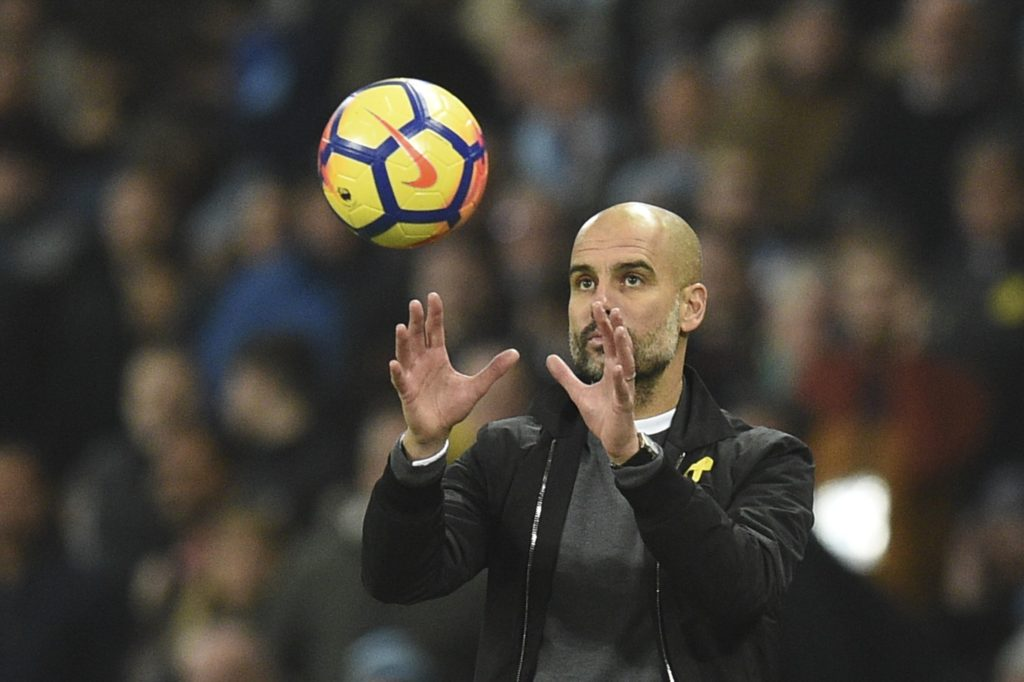 Manchester City's Spanish manager Pep Guardiola catches the ball on the touchline during the English Premier League football match between Manchester City and Bournemouth at the Etihad Stadium in Manchester, north west England, on December 23, 2017. / AFP PHOTO / Oli SCARFF / RESTRICTED TO EDITORIAL USE. No use with unauthorized audio, video, data, fixture lists, club/league logos or 'live' services. Online in-match use limited to 75 images, no video emulation. No use in betting, games or single club/league/player publications.  /