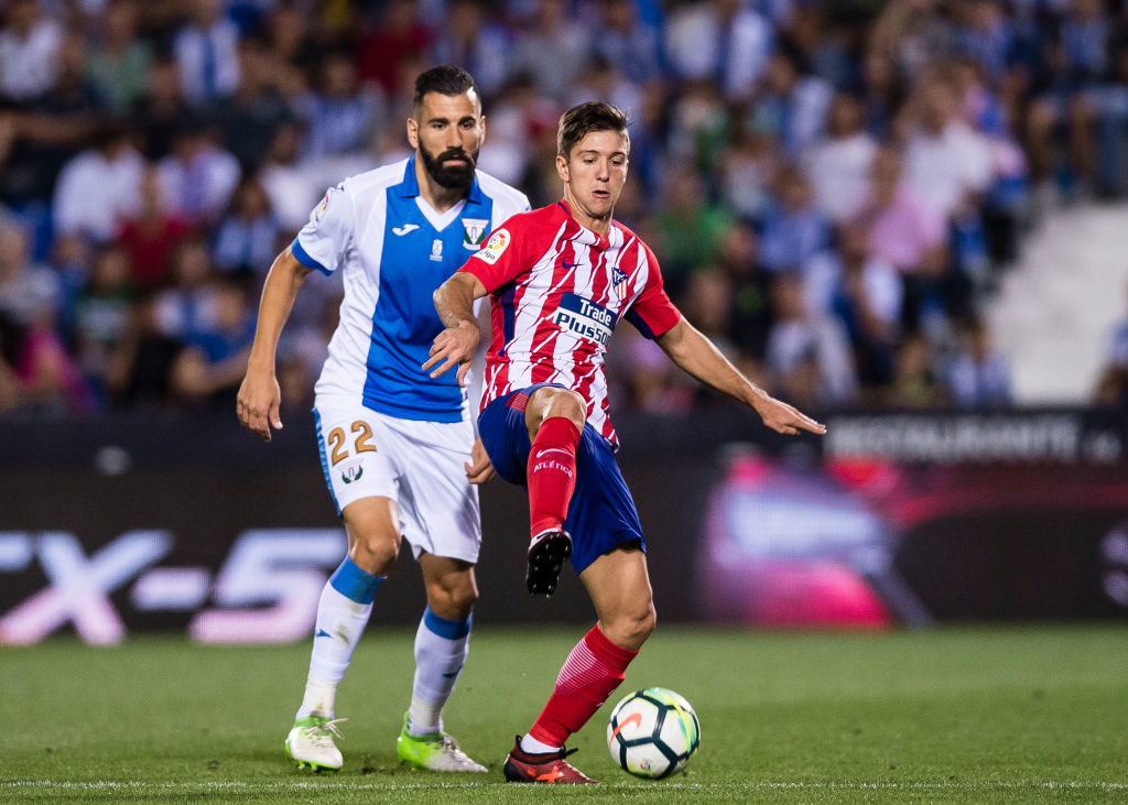 MADRID, SPAIN - SEPTEMBER 30: Luciano Vietto of Atletico de Madrid (R) fights for the ball with Dimitrios Siovas of CD Leganes (L) during the La Liga 2017-18 match between CD Leganes and Atletico de Madrid on 30 September 2017 in Madrid, Spain. (Photo by Power Sport Images/Getty Images)