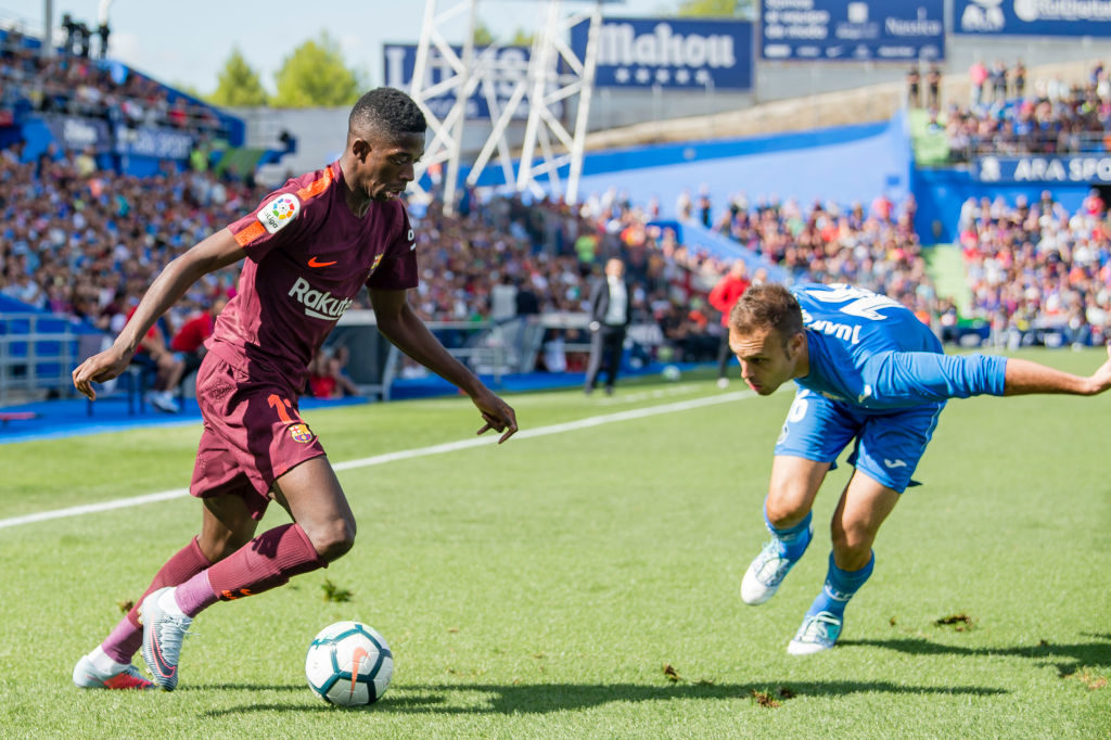 GETAFE, SPAIN - SEPTEMBER 16: Ousmane Dembele of FC Barcelona (L) fights for the ball with Juan Torres Ruiz, Cala, of Getafe CF (R) during the La Liga 2017-18 match between Getafe CF and FC Barcelona at Coliseum Alfonso Perez on 16 September 2017 in Getafe, Spain. (Photo by Power Sport Images/Getty Images)