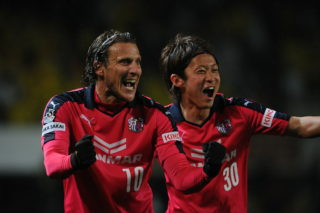 CHIBA, JAPAN - APRIL 01:  (EDITORIAL USE ONLY) Diego Forlan #10 of Cerezo Osaka celebrates the second goal of Cacau during the J.League second division match between JEF United Chiba and Cerezo Osaka at Fukuda Denshi Arena on April 1, 2015 in Chiba, Japan.  (Photo by Masashi Hara/Getty Images)